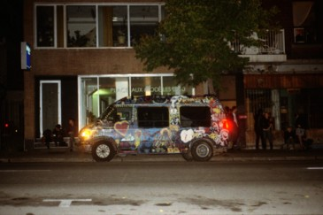 Hollerado's van parked in front of a popular party spot, the Nacho House.