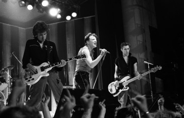 The Looters performing at PNE Gardens on set. Left to right: Steve Jones (guitarist of the Sex Pistols); Ray Winstone (actor, Quadrophenia); Paul Simonon (bassist of the Clash) | | photo by Bev Davies
