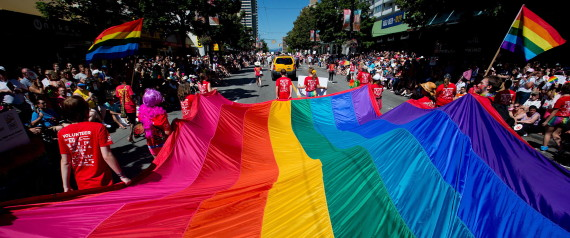 A giant rainbow flag is carried down Robson Street during the Vancouver Pride Parade in Vancouver, B.C., on Sunday August 5, 2012. Organizers expected as many as 600,000 people to take in the parade which is one of the largest in North America. THE CANADIAN PRESS/Darryl Dyck
