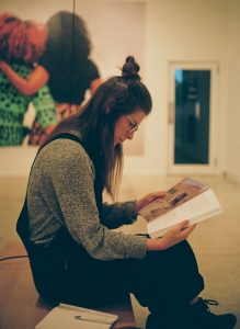 side profile photo of Jessica Johns reading a book